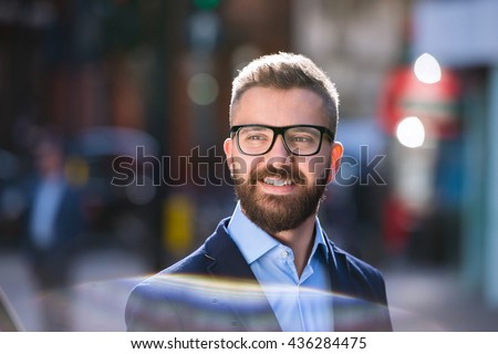 Hipster manager in blue shirt walking in the street - stock photo