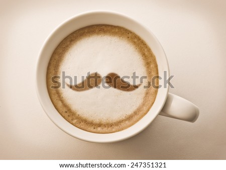 hipster mustache drawing on latte art coffee cup - stock photo