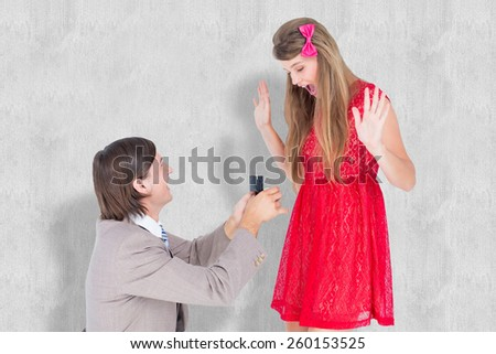 Hipster on bended knee doing a marriage proposal to his girlfriend against white background - stock photo