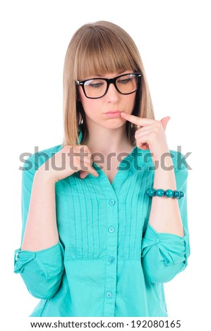 Hipster smart girl with glasses with thick frames thinking with finger on her lips, isolated on white - stock photo