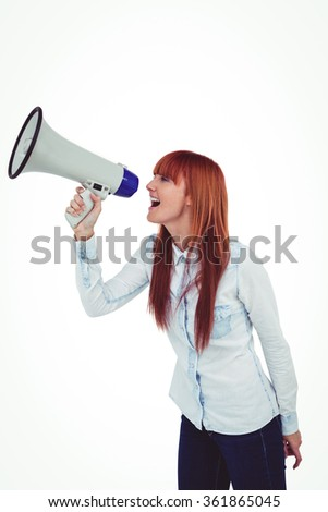 Hipster smiling woman through megaphone against white background