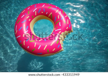 Hipster sprinkled doughnut float in sunny pool background at a slight angle