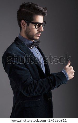 hipster style dressed young guy posing for camera