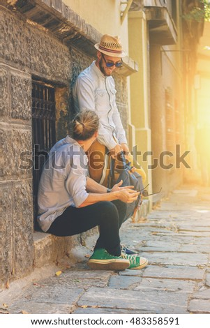 Hipster style guy,travel concept, business concept, Two young attractive guy on the street