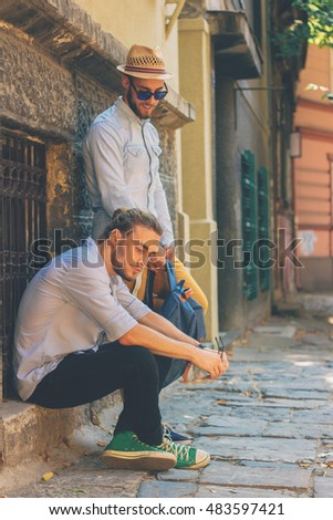 Hipster style guy,travel concept, business concept, Two young attractive guy on the street, twin brothers