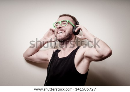 hipster stylish fashion blonde man with headphones on gray background