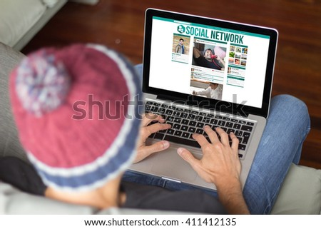 hipster surfing social network. All screen graphics are made up. - stock photo
