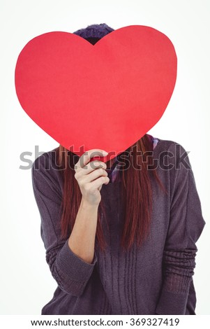 Hipster woman behind a red heart against white background