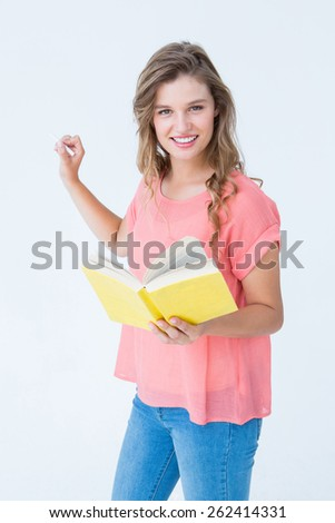 Hipster woman holding book on white background - stock photo