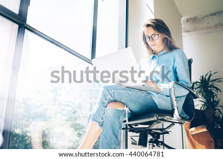 Hipster Woman use Laptop huge Loft Studio.Student Researching Process Work.Young Business Team Working Creative Startup modern Office.Analyze market stock,new strategy.Blurred,film effect.Horizontal - stock photo