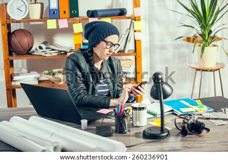 Hipster women in the office - stock photo