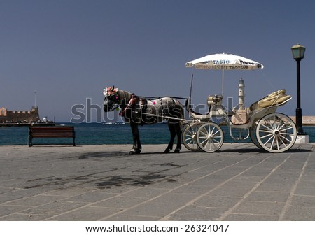 Hiring a horse cab for tourist who visit - stock photo