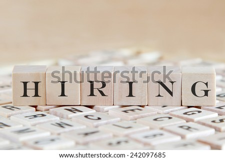 hiring word on wooden cube - stock photo
