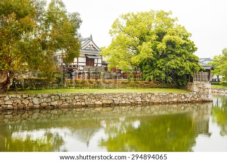 Hiroshima castle in Japan.  Beautiful old caslte on the side of Otagawa river in summer.