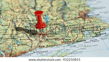 Hiroshima marked on map with red pushpin. Selective focus on the word Hiroshima and the pushpin. Pin is in an angle and casts some shadow to the left.  - stock photo