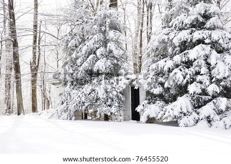 His and Her Outhouses for one-room school in a snow-covered landscape, Webster County, Wets Virginia, USA