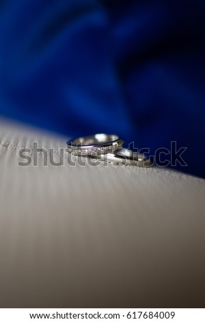 His And Hers Matching Wedding Bands Man And Woman Wedding Bands Laying On The Bed