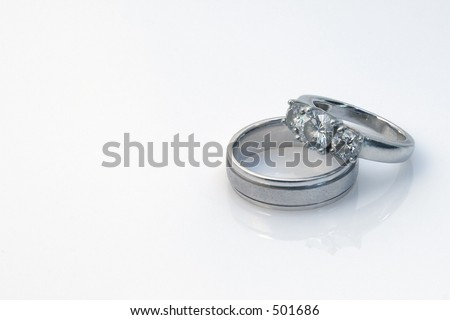His and hers wedding rings - stock photo