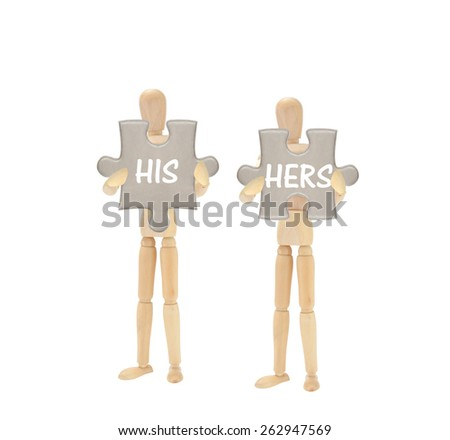 His Hers Mannequins holding puzzle pieces isolated on white background - stock photo
