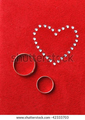 His/ hers wedding rings - stock photo