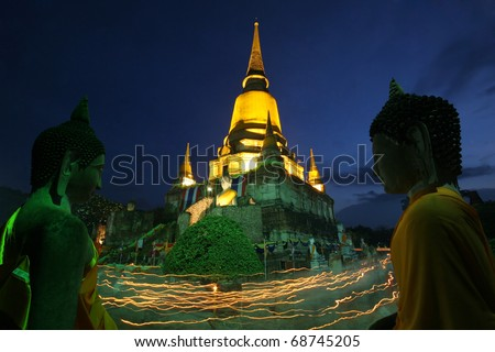 His prayer led by Buddhist monks and the Buddha in Ayutthaya, Thailand - stock photo