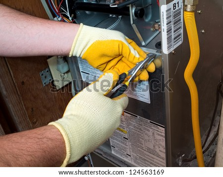 Hispanic air conditioning technician - stock photo