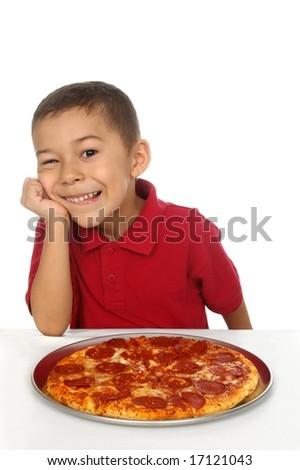 Hispanic boy and pepperoni pizza - stock photo