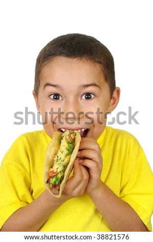 Hispanic boy holding a Mexican-style taco, isolated on white background