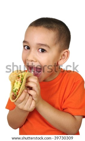 Hispanic boy holding a Mexican taco, isolated on white background
