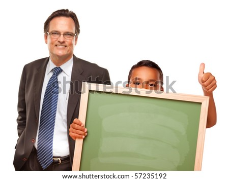 Hispanic Boy Holding Chalk Board with Male Teacher Behind Isolated on a White Background. - stock photo