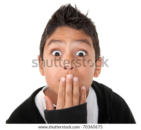 Hispanic boy looking shocked with hand on mouth and raised eyebrows - stock photo