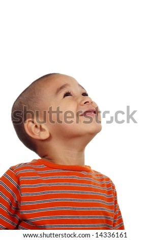 Hispanic boy looking up on a white background - stock photo