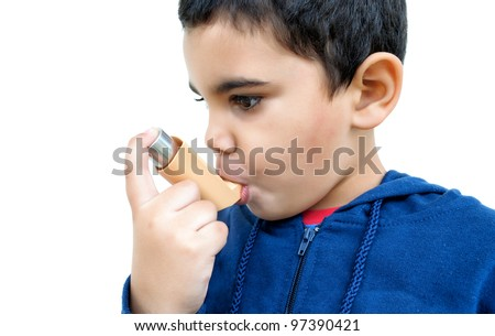 Hispanic boy suffering an asthma attack isolated on white - stock photo