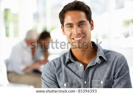 Hispanic businessman in office