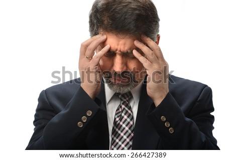 Hispanic businessman under stress isolated over white background - stock photo