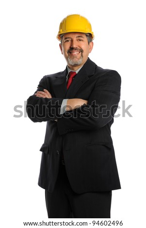 Hispanic businessman wearing hardhat isolated over white background