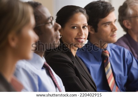 Hispanic businesswoman at a meeting - stock photo