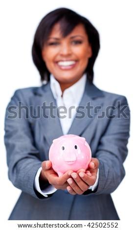 Hispanic Businesswoman holding a piggybank against a white background - stock photo