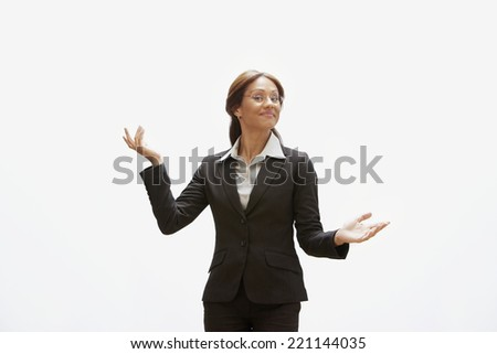 Hispanic businesswoman with arms out - stock photo