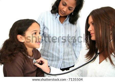 Hispanic child at the doctor - stock photo