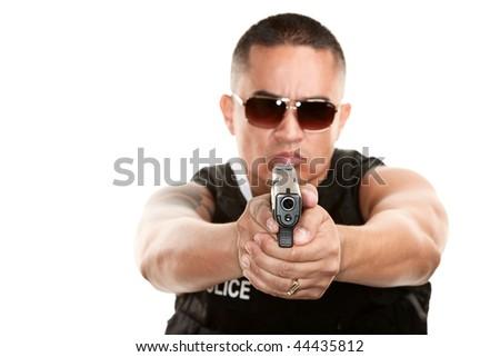 Hispanic Cop in Bulletproof Vest Aiming Pistol - stock photo