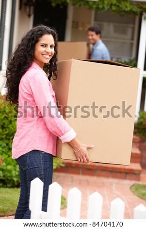 Hispanic couple moving into new house - stock photo