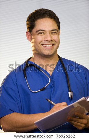 Hispanic Doctor Wearing Scrubs with Stethoscope around Neck
