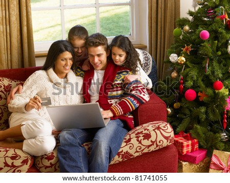 Hispanic family Christmas shopping online - stock photo