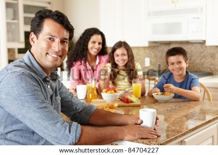 Hispanic family eating breakfast