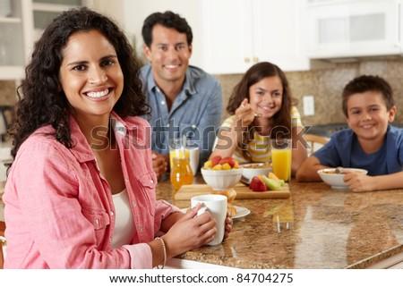 Hispanic family eating breakfast - stock photo