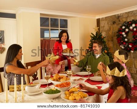 Hispanic family having Christmas dinner - stock photo