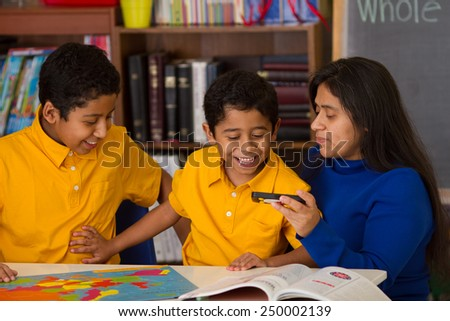 Hispanic Family Looking Having Fun with Puzzle and Phone