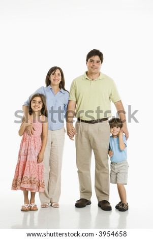 Hispanic family of four standing against white background. - stock photo