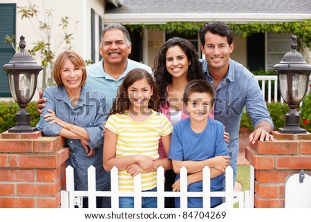 Hispanic family outside home - stock photo